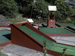 backyard(0.0), swimming pool(0.0), roof(0.0), recreation(0.0), outdoor recreation(0.0), playground(0.0), golf(1.0), miniature golf(1.0),