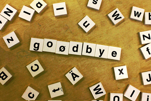 goodbye in scrabble-like tile pieces