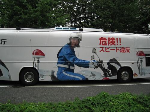 cop on bike on bus