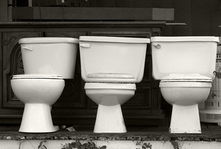 Three toilets (black and white)
