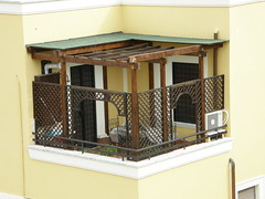 outdoor structure(0.0), cage(0.0), fireplace(0.0), dollhouse(0.0), window(1.0), furniture(1.0), interior design(1.0), facade(1.0), balcony(1.0),