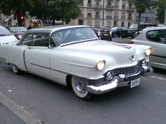 pontiac chieftain(0.0), automobile(1.0), automotive exterior(1.0), cadillac(1.0), vehicle(1.0), full-size car(1.0), antique car(1.0), sedan(1.0), classic car(1.0), land vehicle(1.0), luxury vehicle(1.0),