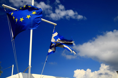 A European flag and a Greek flag