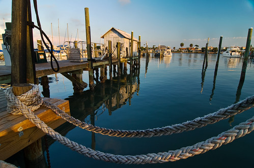 boat dock waterfront rope boathouse suset