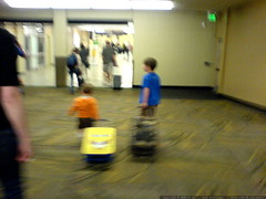 brothers pulling their suitcases through SJC airport…