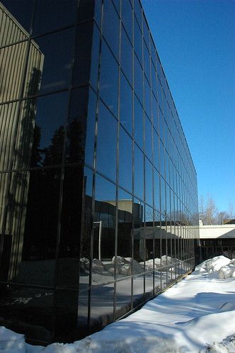 Reflection of the snow and blue sky in the black glass, modern architecture, Consortium Library Exterior, architect Roland H. Lane, University of Alaska, campus, Anchorage, Alaska, USA by Wonderlane