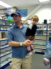 grandpa jeff helping sequoia check out the gift shop…