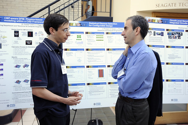 CSSI researchers hold discussions during the poster session.
