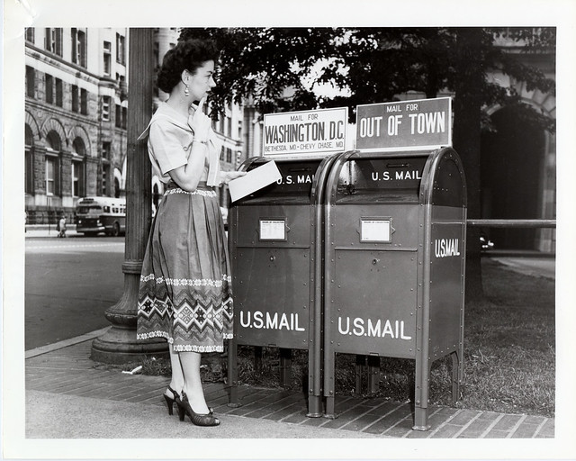 Woman Mailing a Letter