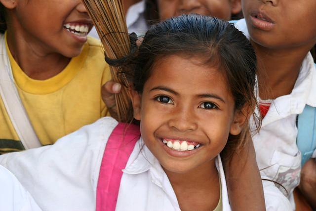 A little girl in a school uniform in Timor, Indonesia.