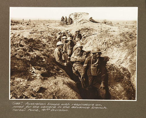 """Gas."" Australian troops with respirators on posed for the camera in the advance trench, Garter Point, 4th Division"