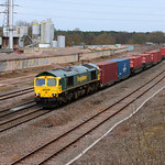 66590 hauls a southbound intermodal service past the Lafarge plant at Banbury 7 March 2009