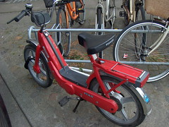 sports equipment(0.0), racing bicycle(0.0), moped(1.0), road bicycle(1.0), wheel(1.0), vehicle(1.0), piaggio ciao(1.0), bicycle frame(1.0), bicycle(1.0),