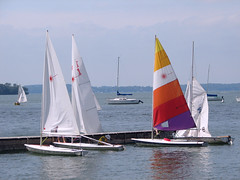 sailing ship(0.0), keelboat(0.0), ship(0.0), lugger(0.0), catamaran(0.0), yacht racing(1.0), sail(1.0), sailboat(1.0), sailing(1.0), sailboat racing(1.0), dinghy(1.0), vehicle(1.0), sailing(1.0), sports(1.0), sea(1.0), skiff(1.0), windsports(1.0), mast(1.0), boating(1.0), watercraft(1.0), dinghy sailing(1.0), boat(1.0),