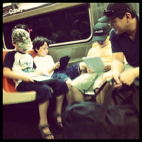 Seriously: 3 little kids with tablet computers on the Q train.