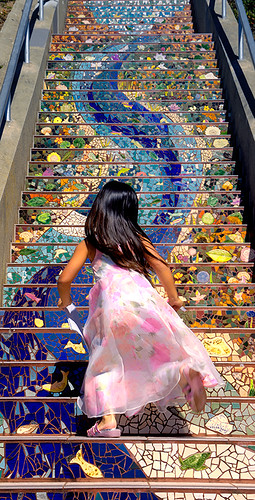 Girl runs up San Francisco's 16th Avenue Tiled Steps
