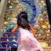 Girl runs up San Francisco's 16th Avenue Tiled Steps by Abe K