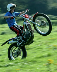 mountain bike(0.0), sports equipment(0.0), downhill mountain biking(0.0), mountain biking(0.0), bicycle(0.0), automobile(1.0), racing(1.0), freestyle motocross(1.0), wheel(1.0), vehicle(1.0), motorcycle(1.0), motorsport(1.0), motorcycle racing(1.0), extreme sport(1.0), motorcycling(1.0), stunt performer(1.0), land vehicle(1.0), stunt(1.0),