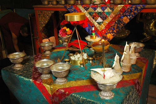 Vajrayogini Empowerment Torma with sindhura powder, ritual spoon, rice heaps, tripod, skullcup, saffron nectar, and candles for diety offering on silk, shrine, Tharlam Monastery, Boudha, Kathmandu, Nepal