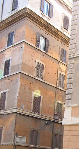 Bullet-holes on ochre stucco