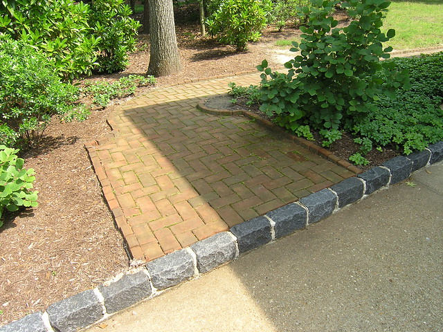 Cobble edging and brick walkway flickr photo sharing for Brick sidewalk edging