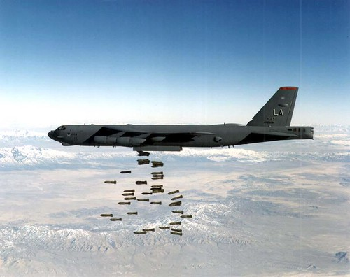 A B-52H drops a load of M117 750lb bombs