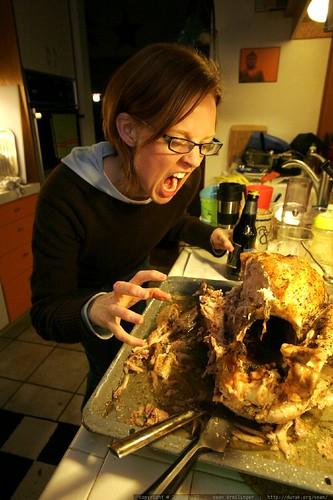 kat clawing at the turkey carcass    MG 0115