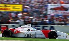 stock car racing(0.0), performance car(0.0), race car(1.0), auto racing(1.0), automobile(1.0), racing(1.0), sport venue(1.0), vehicle(1.0), sports(1.0), race(1.0), open-wheel car(1.0), race of champions(1.0), motorsport(1.0), sports prototype(1.0), indycar series(1.0), formula one(1.0), formula one car(1.0), race track(1.0), sports car(1.0),