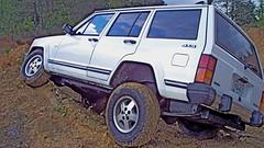 automobile(1.0), automotive exterior(1.0), sport utility vehicle(1.0), jeep cherokee (xj)(1.0), wheel(1.0), vehicle(1.0), compact sport utility vehicle(1.0), off-roading(1.0), jeep(1.0), bumper(1.0), land vehicle(1.0),