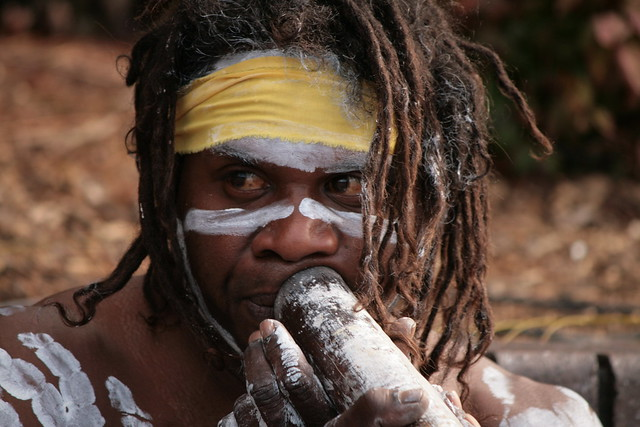 Native Australian Aboriginal Person playing the Digeridoo