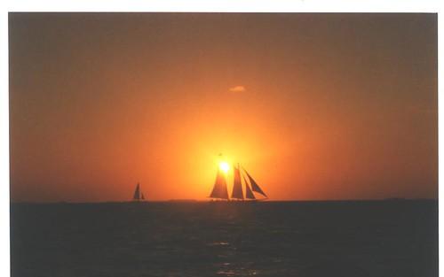 ocean pink blue sunset sky orange beach clouds sailboat hawaii florida horizon maui palmtrees keywest sunrisesunsetanythingsun naturephotographers orangeskies nowthatssky natureplus 10millionphotos exquisitesunsets