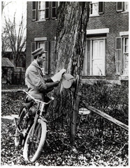 Letter Carrier Delivering Mail by Bicycle by Smithsonian Institution