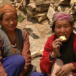 Nepali Women with Biscuits - Annapurna Circuit, Nepal