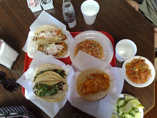 Fish tacos a tableau women with drills wierdness for Best fish tacos near me