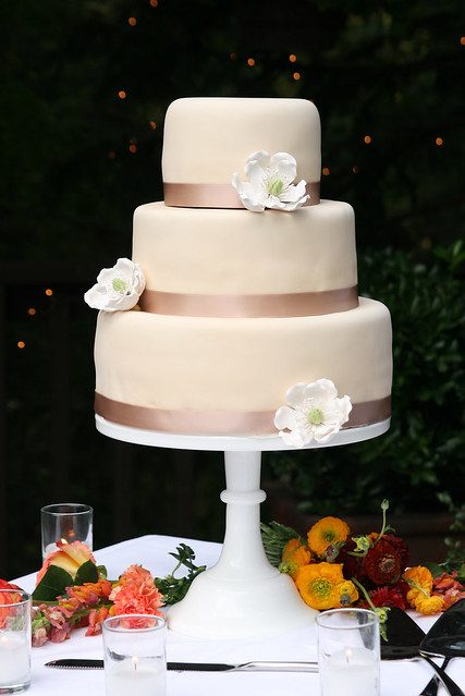 6912 inch tiers fondant wedding cake Ivory with champaigne ribbon and