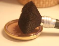 hand(0.0), shave brush(0.0), finger(0.0), tool(0.0), lip(0.0), eyelash(0.0), human body(0.0), eye(0.0), organ(0.0), brown(1.0), brush(1.0), cosmetics(1.0),