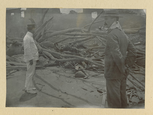 Mt. Pelee: [Two men and body, result of eruption of Mt. Pelee on Martinique]