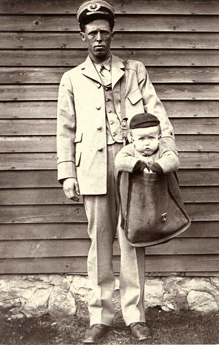 Uniformed Letter Carrier with Child in Mailbag