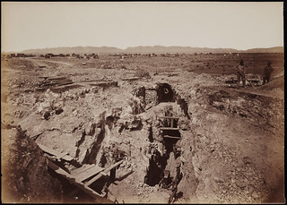 [No. 1310. Old South Shaft Ore Quarry, Tough-nut Mine. Part of Town of Tombstone. Dragoon Mountains, with Cochise Stronghold in back-ground, Arizona].