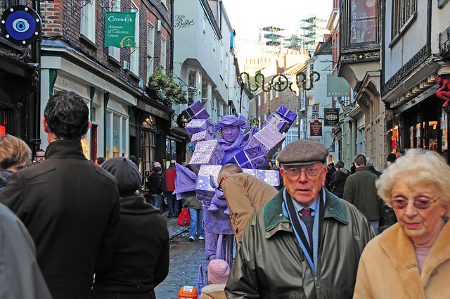 Purple Man on Bicycle, Living Street Art, Sculpture with Passers-by, City of York