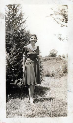 girl in dark dress white collar