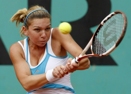 Romania 39s Simona Halep returns the ball to compatriot Elena Bogdan during