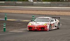 ferrari f430(0.0), race car(1.0), auto racing(1.0), automobile(1.0), racing(1.0), sport venue(1.0), vehicle(1.0), stock car racing(1.0), performance car(1.0), race(1.0), automotive design(1.0), ferrari f430 challenge(1.0), race track(1.0), land vehicle(1.0), luxury vehicle(1.0), supercar(1.0), sports car(1.0),