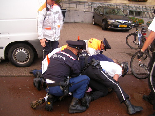 7 Police Men Arresting 1 Man - Coolsingel - Rotterdam - Holland by Leo Roubos