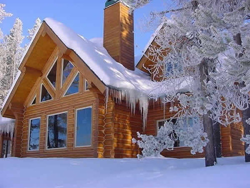 snow covered wooden home