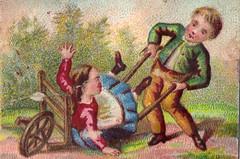 Boy pushing Girl In A Wheelbarrow
