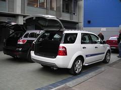 ford escape hybrid(0.0), automobile(1.0), automotive exterior(1.0), sport utility vehicle(1.0), wheel(1.0), vehicle(1.0), compact sport utility vehicle(1.0), crossover suv(1.0), ford escape(1.0), bumper(1.0), land vehicle(1.0),
