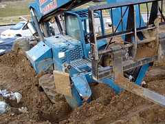 bulldozer(0.0), tractor(0.0), soil(1.0), vehicle(1.0), plough(1.0), agricultural machinery(1.0), construction equipment(1.0), land vehicle(1.0),