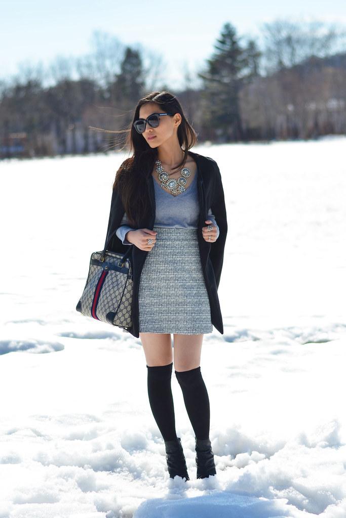 black cape coat, tweed skirt, over knee socks outfit