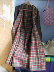 pattern(0.0), kilt(0.0), dress(0.0), pattern(1.0), textile(1.0), clothing(1.0), sleeve(1.0), outerwear(1.0), design(1.0), tartan(1.0), plaid(1.0),